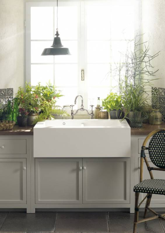 A Corian Bold Farmhouse Sink 690 In Glacier White Teamed With Countertop Sonora