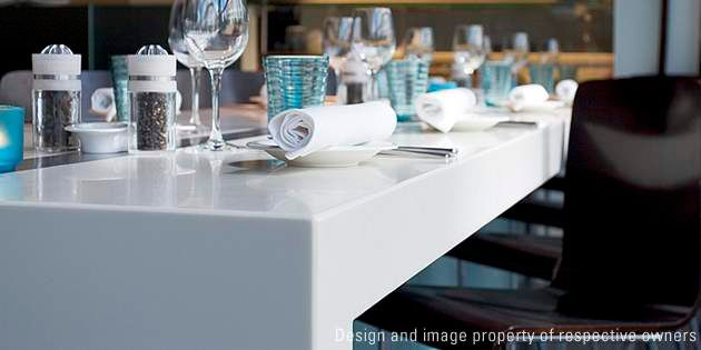 HighPerformance Restaurant Design At The Radisson Hotel Corian - Corian restaurant table tops
