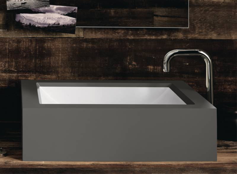 Corian® Chic Sink 7412 is enclosed within a box-style mount of Corian® Deep Cloud. Bathroom Basins